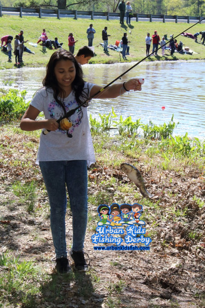 Arianna U. is Urban Kids Fishing Derby Atlanta biggest catch winner.